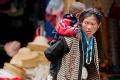 Carrying Child, Market, Shigatse, Tibet
